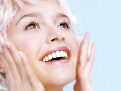 Florida veneers smiling woman with her hands on her face